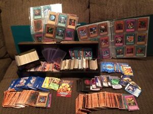 1500 yu-gi-oh cards, binders with holders