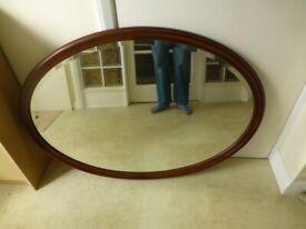 Huge oval shape over mantle mirror