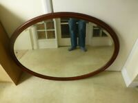Huge oval shape over mantle mirror