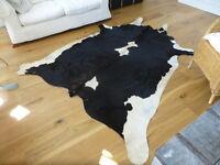 Cowhide Rug. Beautiful unused rug, extra large, black & white