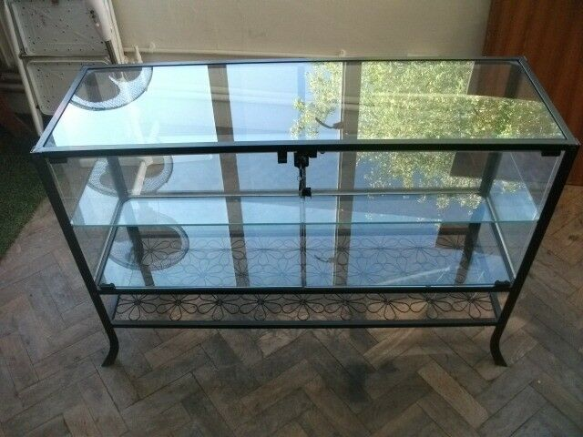 Glass Cabinet . Metal frame . Very good condition .