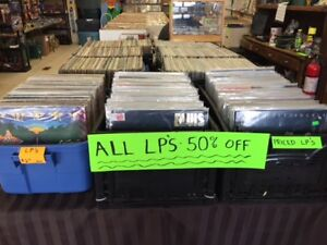 THIS WEEK AT COOL WORLD-RECORD ALBUM BLOWOUT