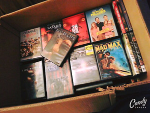BIG box of assorted DVDS.