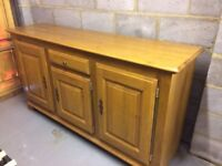 French oak sideboard. Immaculate as new. 3 lockable cupboards, shelved inside. Plus drawers.