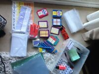 Box of assorted stationery and teaching tools