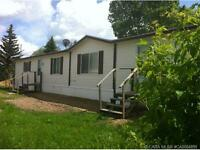 Lowest Price In Clive<AB. 2006 Built home **OWN LOT!!