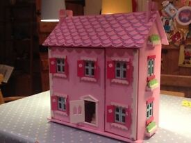 Lovely Wooden Dolls house with furniture and family