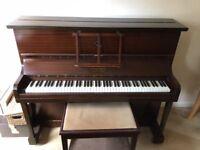 Piano -Upright with piano stool.