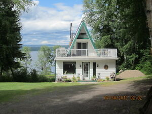 5 acres with lakefront on Fraser Lake with shop