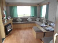 very cheap static caravan for sale on flagship resort, blue flag beach, swimming, fishing,golf