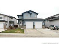 2 STOREY HOME IN SW SOUTHRIDGE WITH PARTIAL VIEW & RV PARKING