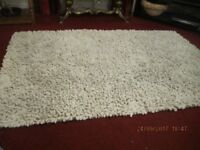 off white large cotton rug