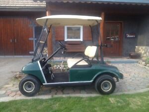 TWO USED............WELL MAINTAINED..........GAS GOLF CARTS
