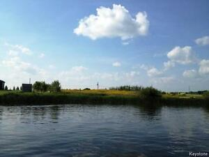 Landscaped 1.18 acre lakefront property in Shoal Lake Mb