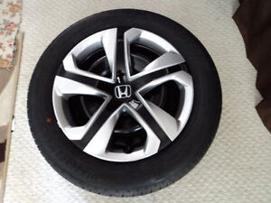 All season tire with rims