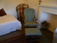 Sturdy rocking armchair and matching stool, could be used as nursing chair