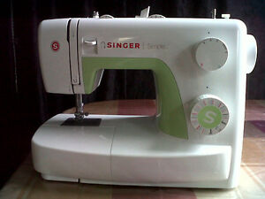 Singer Sewing Machine (new condition)