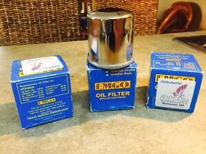 For sale are 3 new chromed oil filters for many Honda motorcycle
