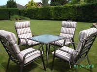 Garden Furniture: Glass Table: C/W 4 cushioned chairs.