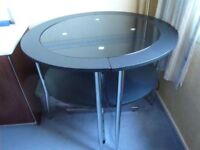 Black dining set. Love table and 2 chairs. As new.
