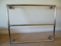 Chrome coloured wall mounted towel heater older style