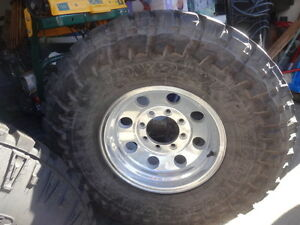 "Aluminum rims 8x16x6.5"" 8 bolt with 315 75 r16 tires"