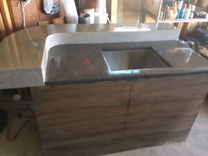 Concrete countertop with stainless steel sink and base