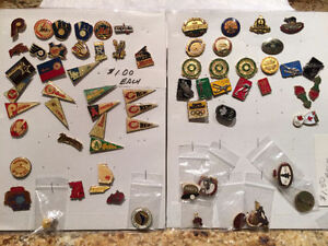 Large assortment of older - new style of lapel pins. Sold in lot