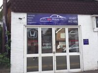 Single bay motor trades workshop with established use on busy road just outside Guildford.