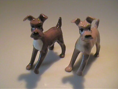 TWO VINTAGE MINIATURE HAGEN RENAKER TRAMP LIKE DOGS