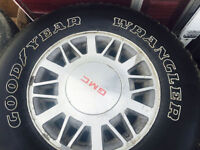 235/75/15 tires with Rims 90% new call 403 903 3044