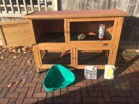 Two tier rabbit hutch suitable for 2 rabbits with many extras.