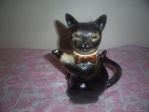 tea pot collectible.Metal sculptures golfer.