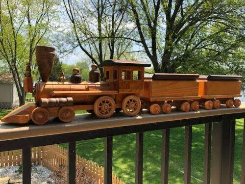 Vintage wooden and metal train. Locomotive and 2 cars