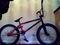 bmx mafia bike kush red and black and good condition with green front tire and new front brake