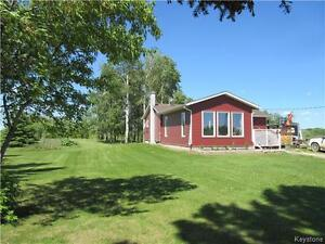 Country living at its best! 9.74 acres near Rossburn Mb