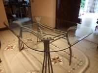 Glass Dining room table and 6 chairs