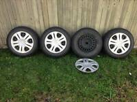 """15"""" WINTER STUDDED TIRES on RIMS with HUBCAPS"""