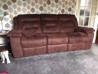 One three seater and one two seater faux suede suite.