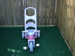 Girl Fisher Price tricycle with handle