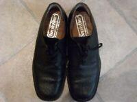 Pair of Men's Black leather shoes