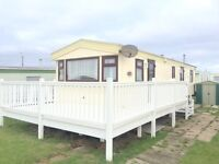Cheap double glazed caravan for sale with a huge DECKING! Sea views , dog friendly , fishing lake!!