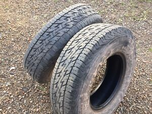 Two used 235 85 R16 load range e tires