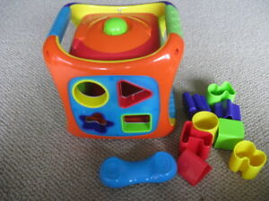 Set of kid's toys for sale: learning cube, radio etc