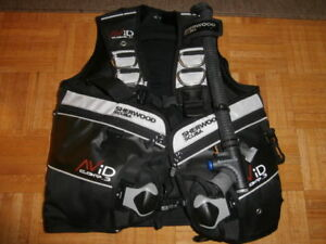 Scuba eqpt - brand new BCD; used mask, snorkel, boots,hood, etc.