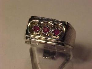 #3296-10K White Gold With 3 natural rubies.Size 8-Appraised @ 1550.00 Sell $495.  FREE S/H CANADA ONLY ACCREDITED BBB