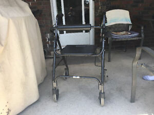 LIKE NEW FOLD UP WALKER WITH DUAL LOCKING BRAKES