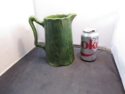 antique green pitcher