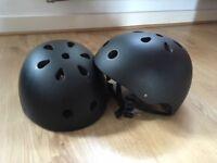 Two bike/skate helmets