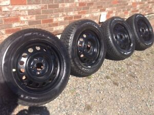 Like new winter studded tires on rims - less than 1 month used -